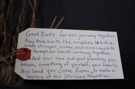 the shipping tag attached to the boots, ready for travel and completion