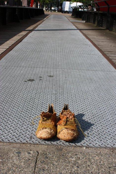 shoes on train turnstile